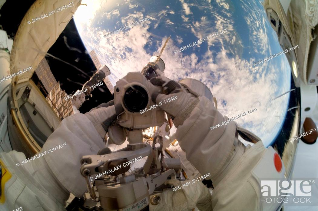 Stock Photo: Expedition 33 Flight Engineer Akihiko Hoshide takes a picture of his helmet visor while participating in a 6-hour, 38-minute spacewalk outside the International.