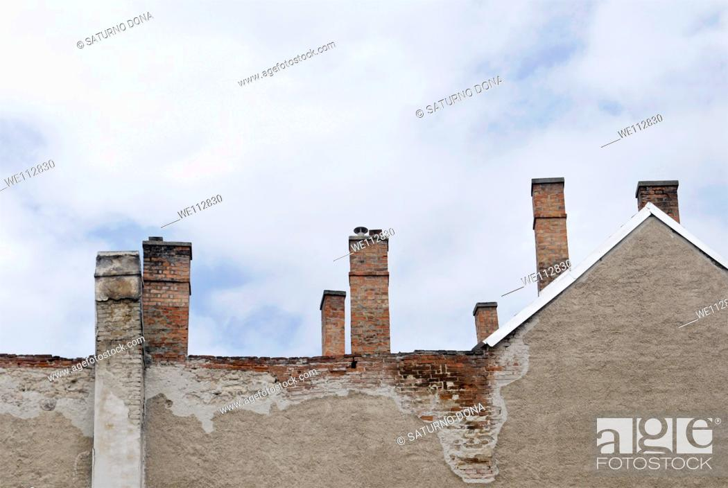 Stock Photo: old house with chimneys.