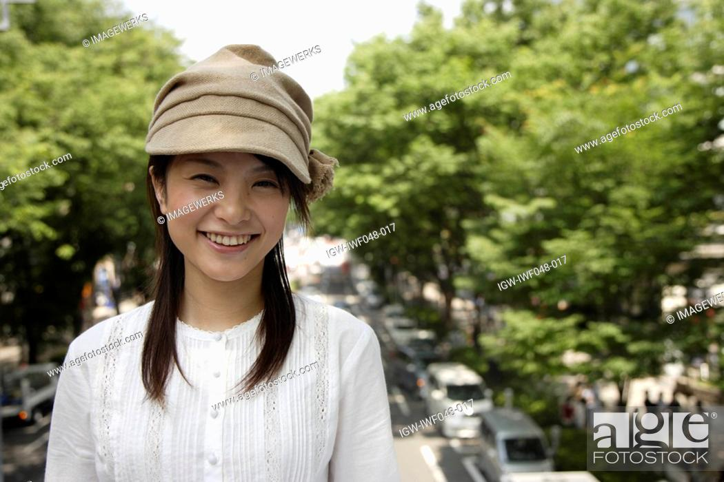 Stock Photo: Portrait of a young woman smiling.