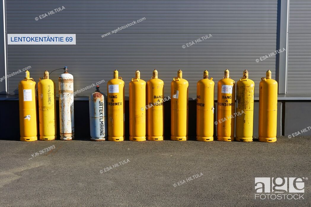 Stock Photo: yellow gas cylinders.