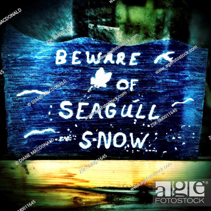 Stock Photo: Humorous sign on Jacksonville Beach Pier, Jacksonville Beach, Florida, USA.