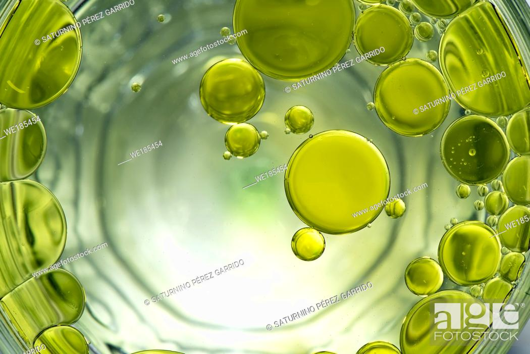 Stock Photo: Oil drops on water forming circles.