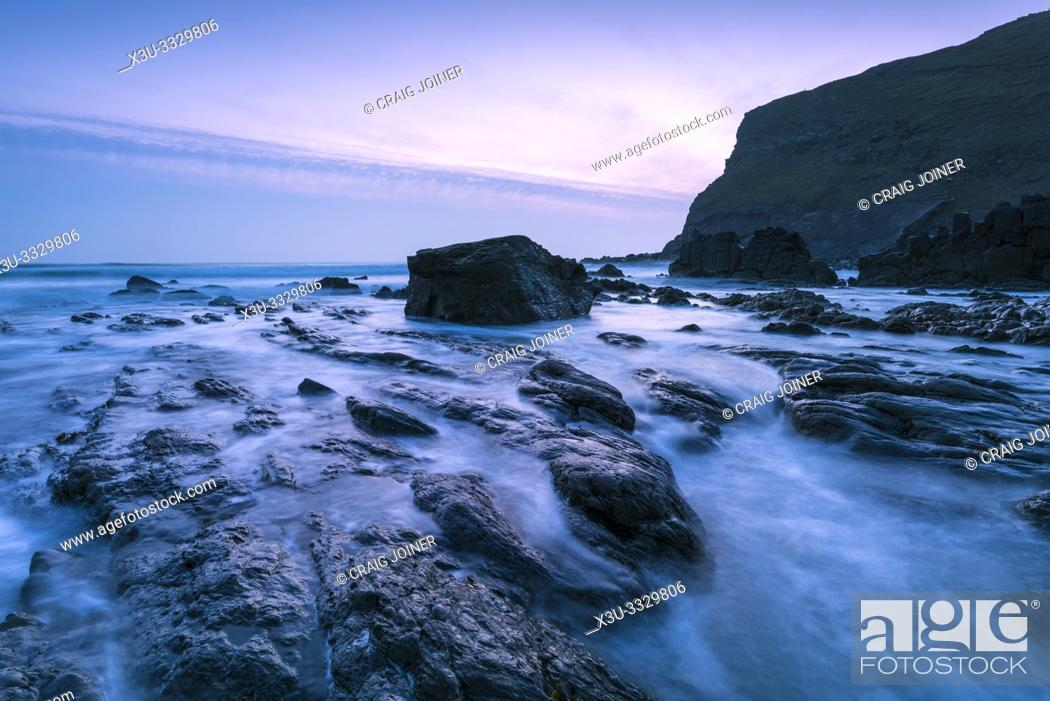 Stock Photo: Rocks exposed by the retreating tide at Duckpool on the Hartland Heritage Coast, North Cornwall, England.