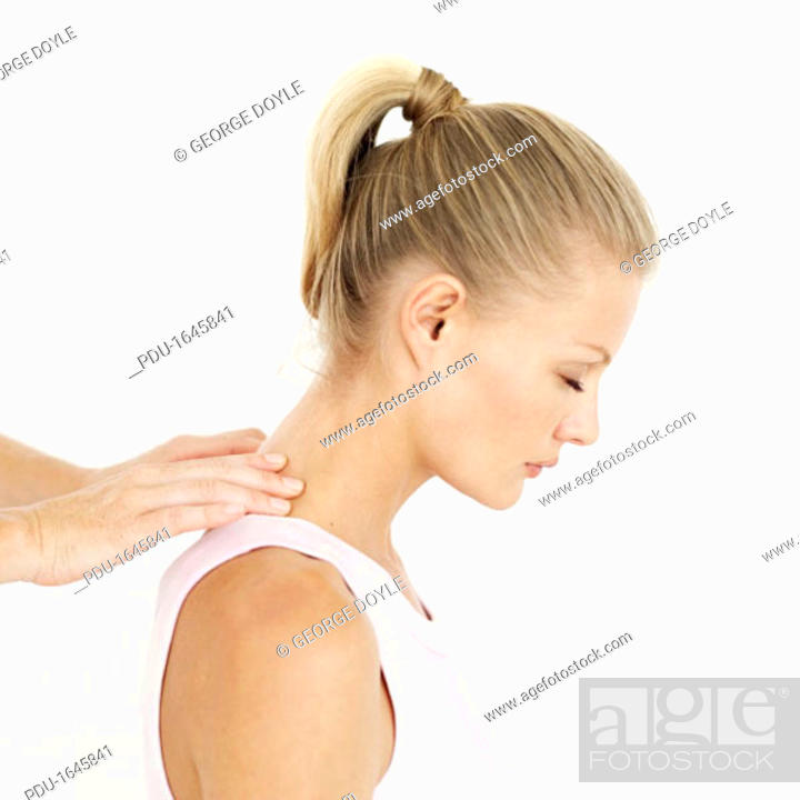 Stock Photo: side profile of a woman getting a shoulder massage.