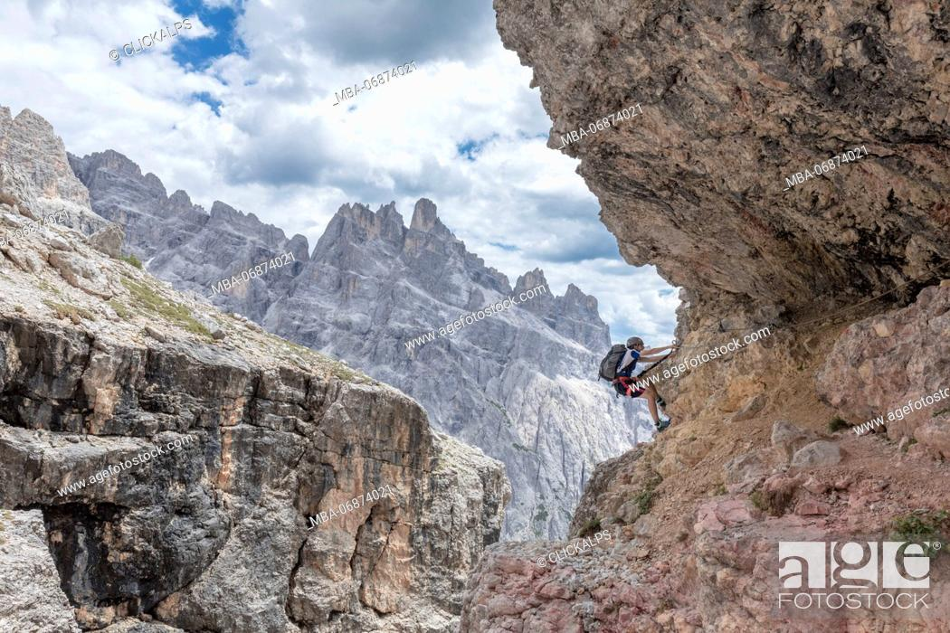 Stock Photo: Climber on the via ferrata Cengia Gabriella, Popera group, Giralba, Sexten Dolomites, Belluno, Veneto, Italy.
