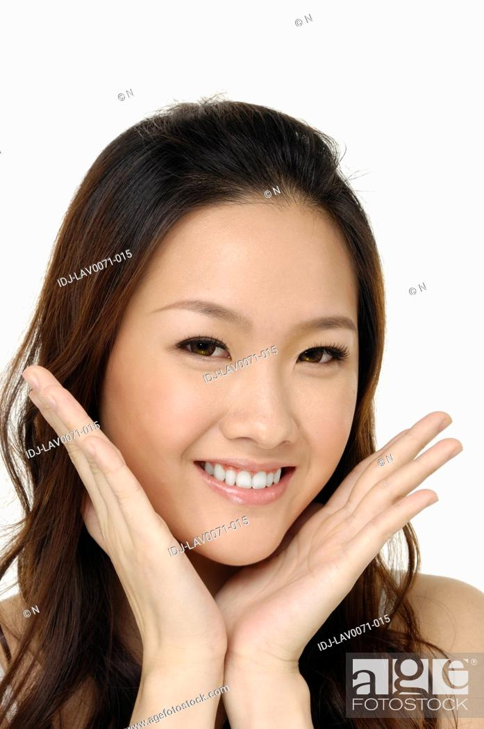 Stock Photo: Portrait of a young lovely woman with health skin of face.