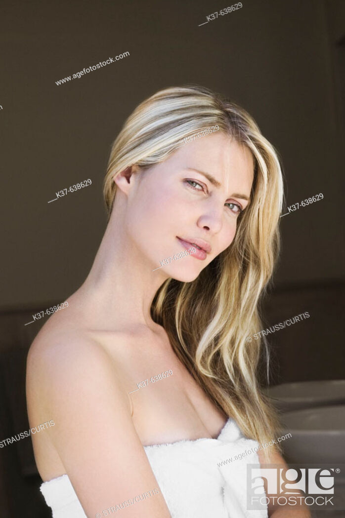 Stock Photo: Close up of neck & profile of young woman with long blonde hair.