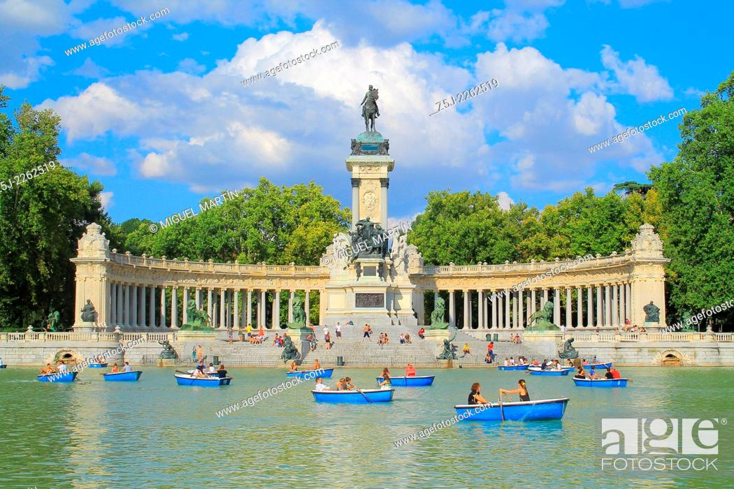 Stock Photo: Monument to Alfonso XII of Spain next to Retiro Park's great pond in Madrid (1922); renting of amusement rowboats remember also the time when it served as the.