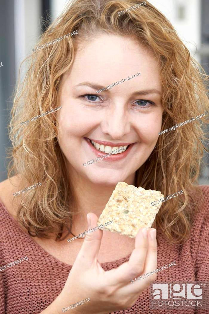 Stock Photo: Woman On Diet Eating Crispbread At Home.
