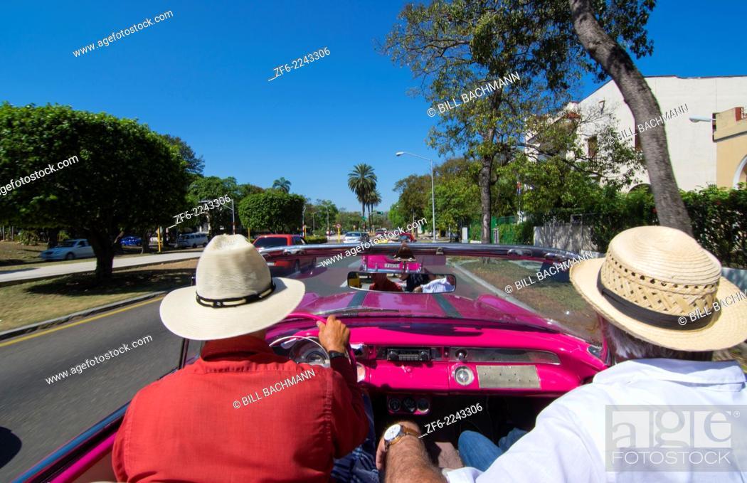 Stock Photo: Havana Cuba driving in classic 1950s convertible around Havana streets with tourists 9.