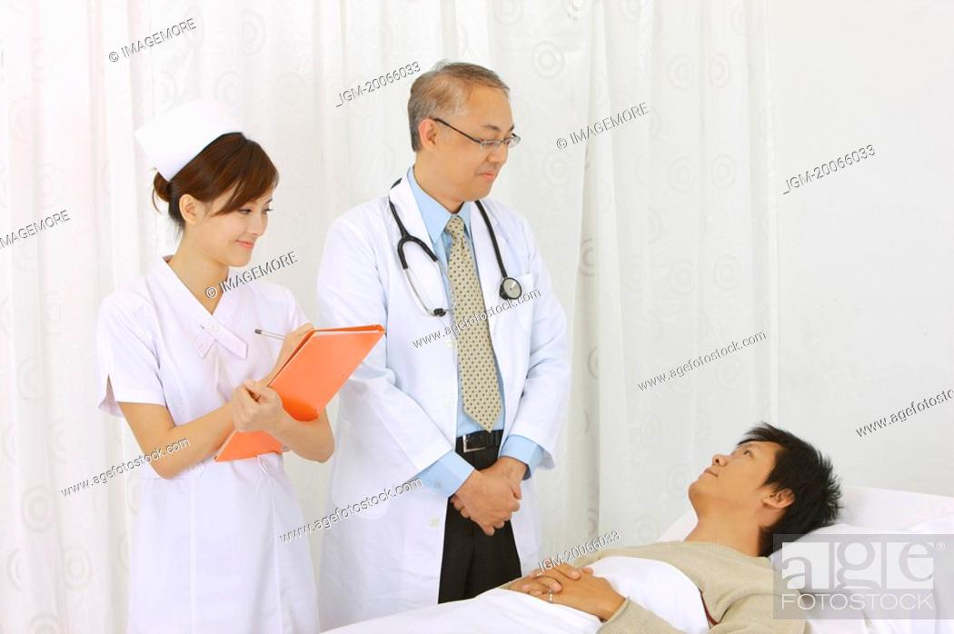 Stock Photo: Doctor and nurse taking care of the patient.