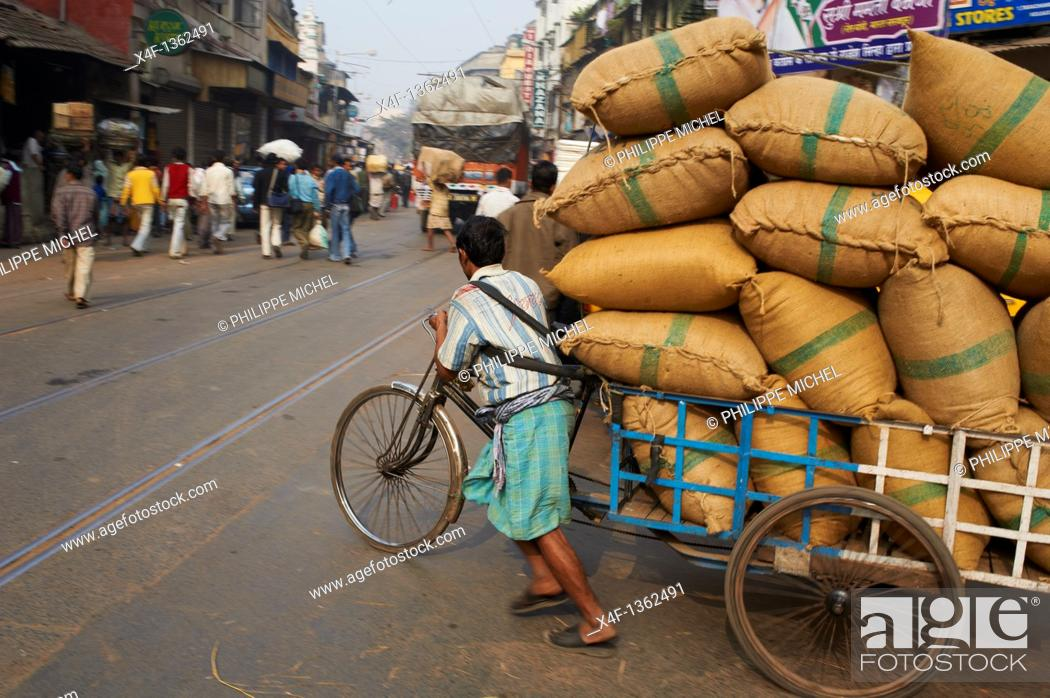 Stock Photo: India, West Bengal, Kolkata, Calcutta, rickshaw on Chitpur street.