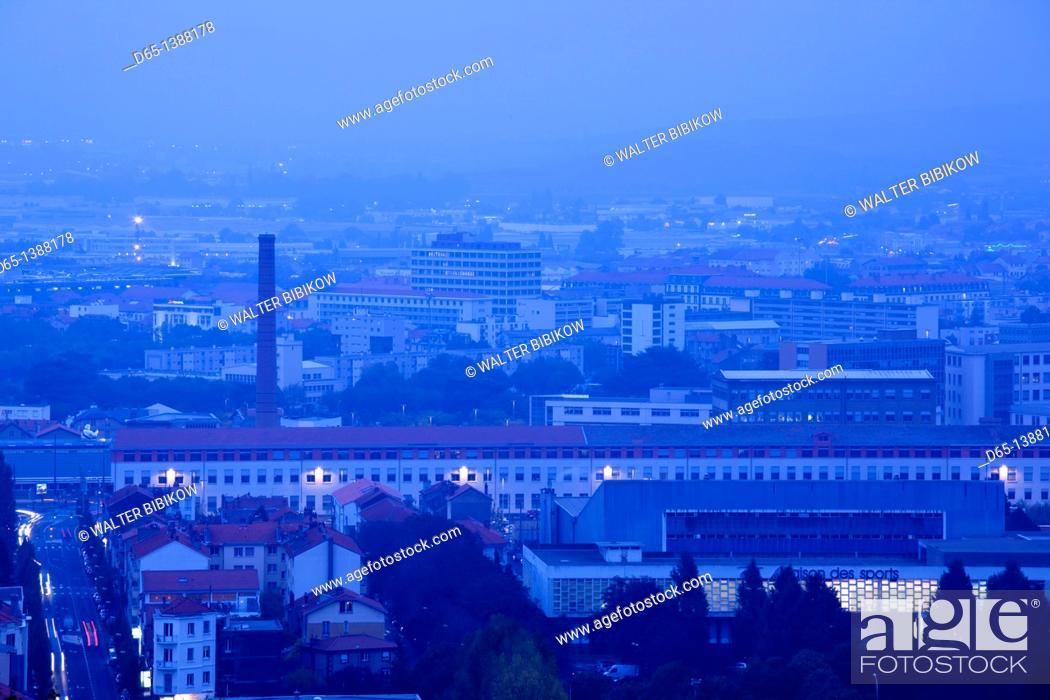 Stock Photo: France, Puy-de-Dome Department, Auvergne Region, Clermont-Ferrand, city overview and Michelin tire factory from Parc de Monjuzet, dusk.