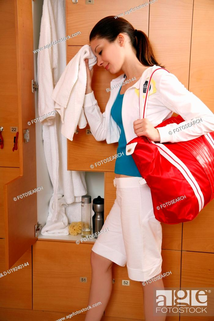Stock Photo: Woman in locker room after work out.