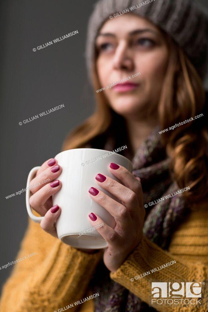 Stock Photo: Nicaraguan woman holding a cup of tea; Toronto, Ontario, Canada.