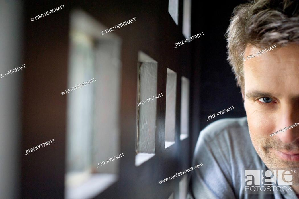 Stock Photo: Portrait of a man smiling.