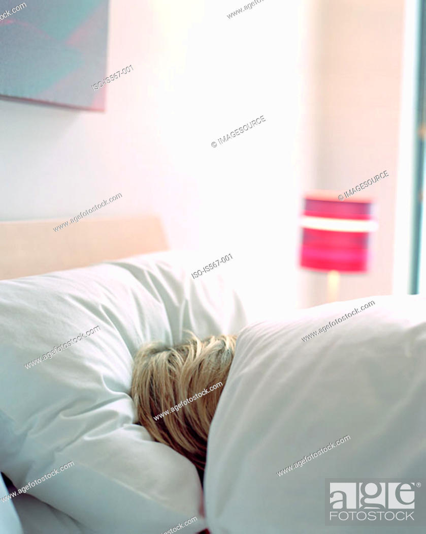 Stock Photo: Woman sleeping in bed.