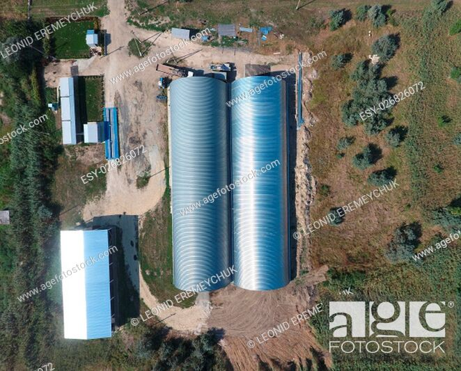 Stock Photo: Top view of the hangars. Hangar of galvanized metal sheets for the storage of agricultural products and storage equipment.