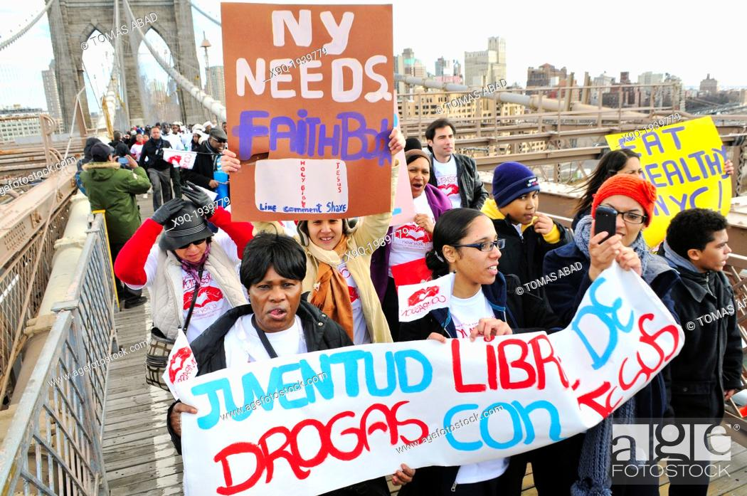 """Stock Photo: Youth, young adults, and adults of the Seventh-Day Adventist Church march across the Brooklyn Bridge during the annual Anti-Violence """"Compassion"""" rally on March."""
