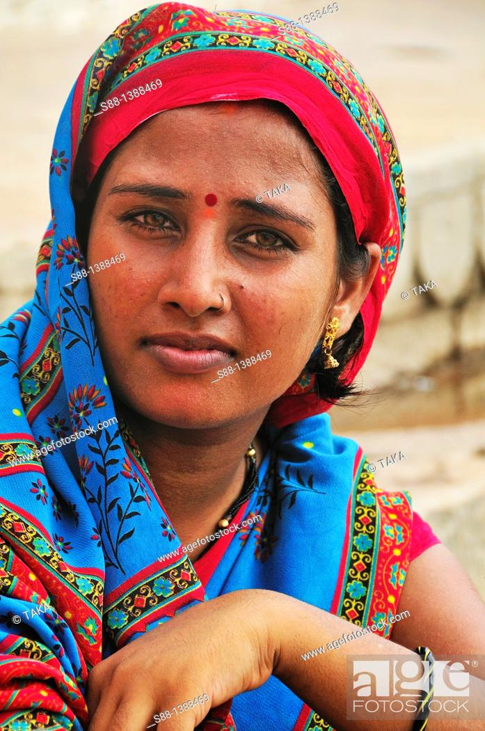 Stock Photo: Woman at the ghat by the Ganges River.