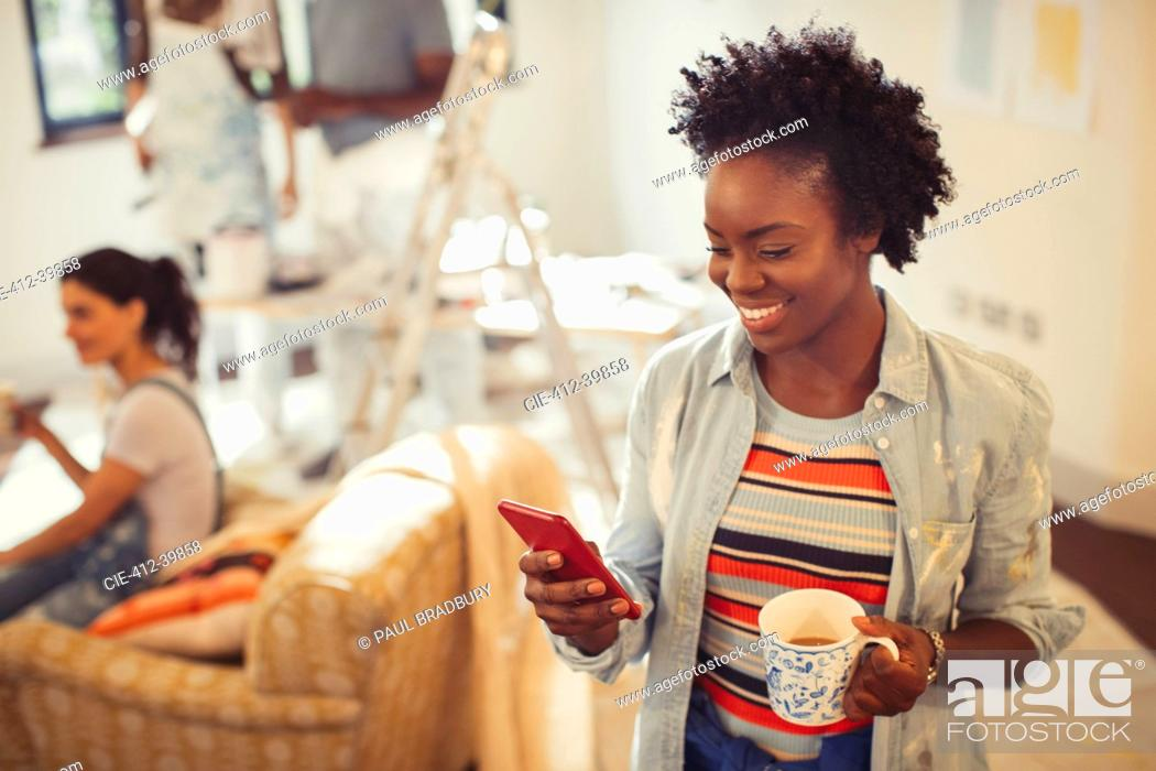Stock Photo: Woman drinking coffee and texting with smart phone.