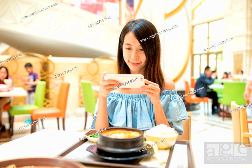 Stock Photo: Woman taking photo on mobile phone before having the meal.