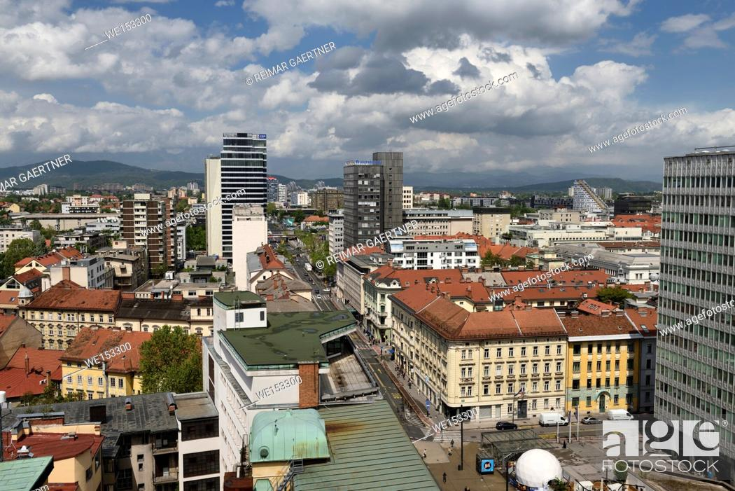 Stock Photo: Elevated view of Ljubljana capital city of Slovenia north from the Skyscraper to the Kamnik Savinja Alps under clouds.