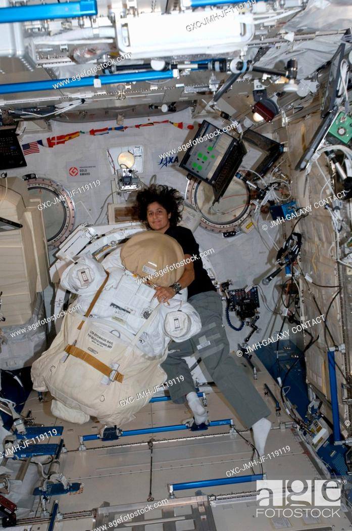Stock Photo: NASA astronaut Sunita Williams, Expedition 32 flight engineer, works with an Extravehicular Mobility Unit (EMU) spacesuit in the Kibo laboratory of the.