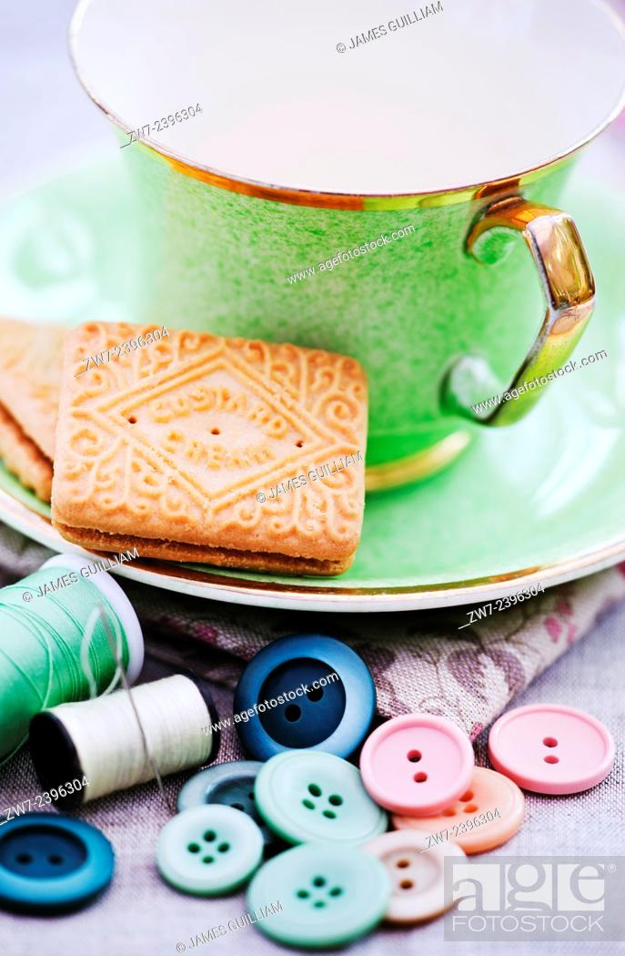 Stock Photo: Tea cup biscuit cotton and buttons.