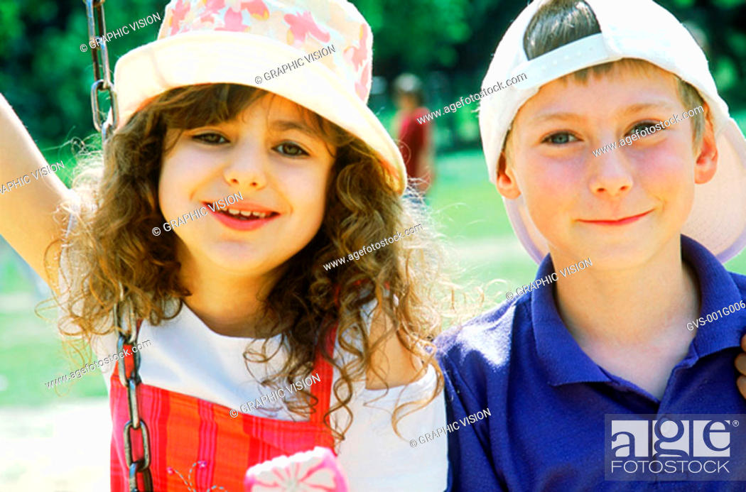 Stock Photo: Portrait of a young boy and a young girl smiling.