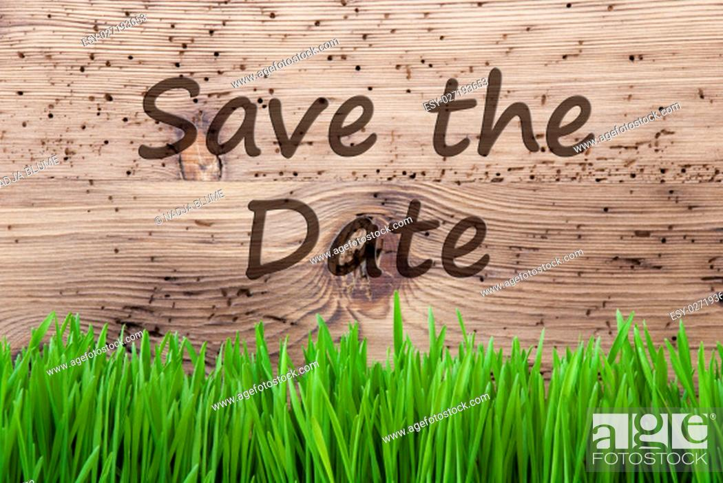 Stock Photo: English Text Save The Date. Spring Season Greeting Card. Bright Aged Wooden Background With Gras.