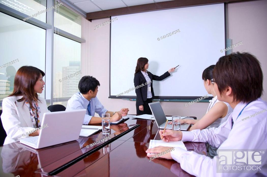 Stock Photo: Business people sitting and listening at meeting together.