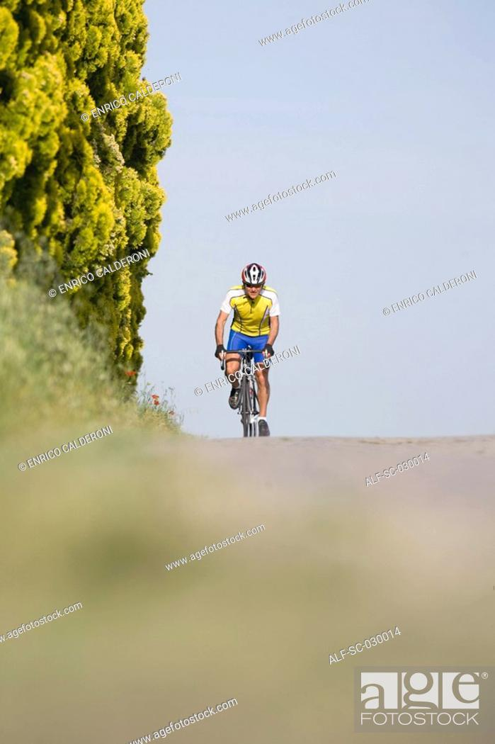 Stock Photo: Cyclist riding bicycle, front view.