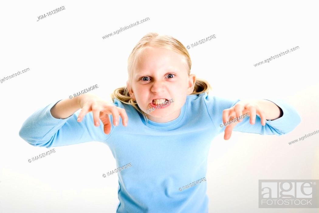 Stock Photo: One girl making a face , mischief, close-up.