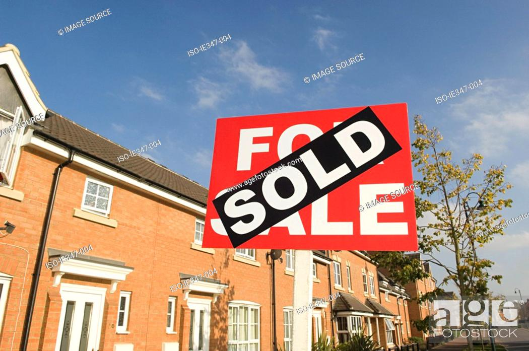 Stock Photo: Sold sign and houses.