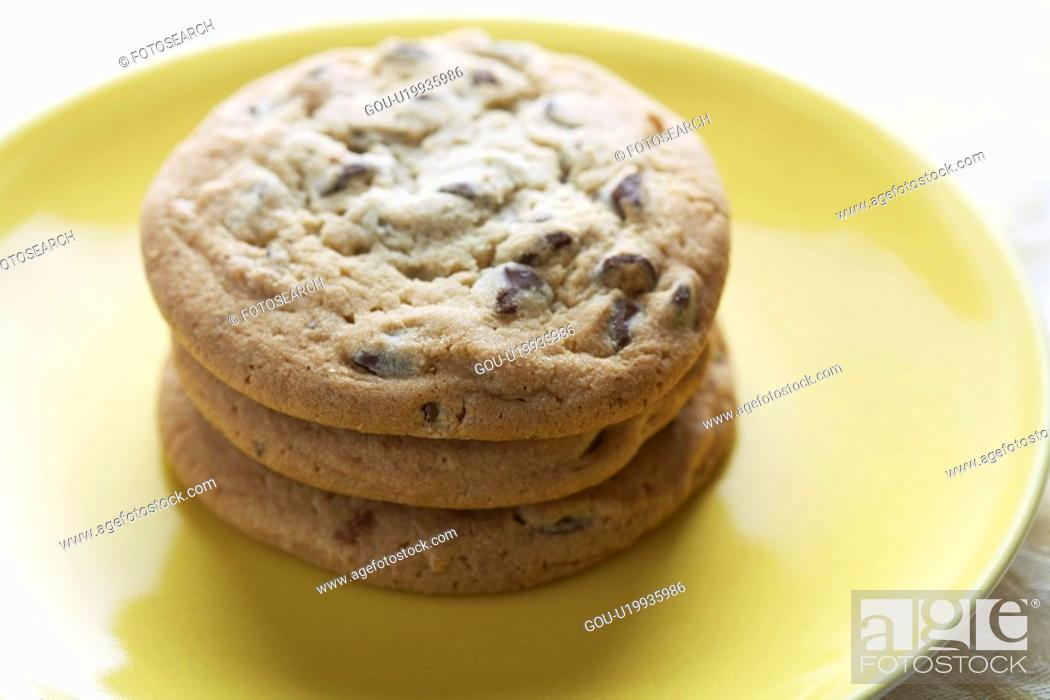 Stock Photo: Chocolate chip cookies on plate.