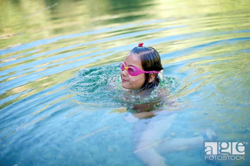 Stock Photo: girl with underwater glasses swimming on a river , Villahermosa river, Ludiente, Castellón, Spain.