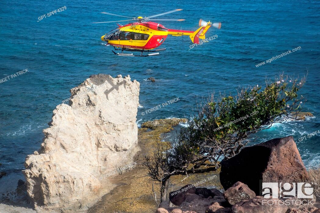 Stock Photo: RECONNAISSANCE MISSION TO LOOK FOR PEOPLE WHO DISAPPEARED AROUND THE PETIT ANSE OF THE ANSES D'ARLET, HELICOPTER RESCUE WITH THE CIVIL SECURITY'S DRAGON 972.