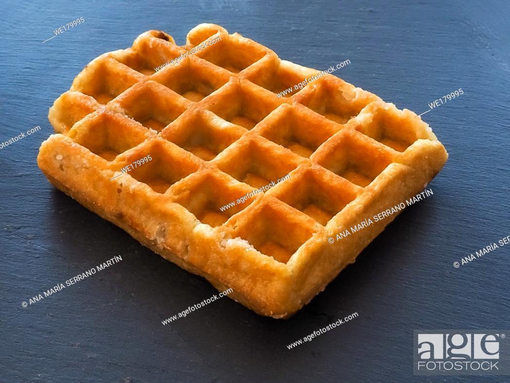 Imagen: A Belgian waffle on a slate plate.