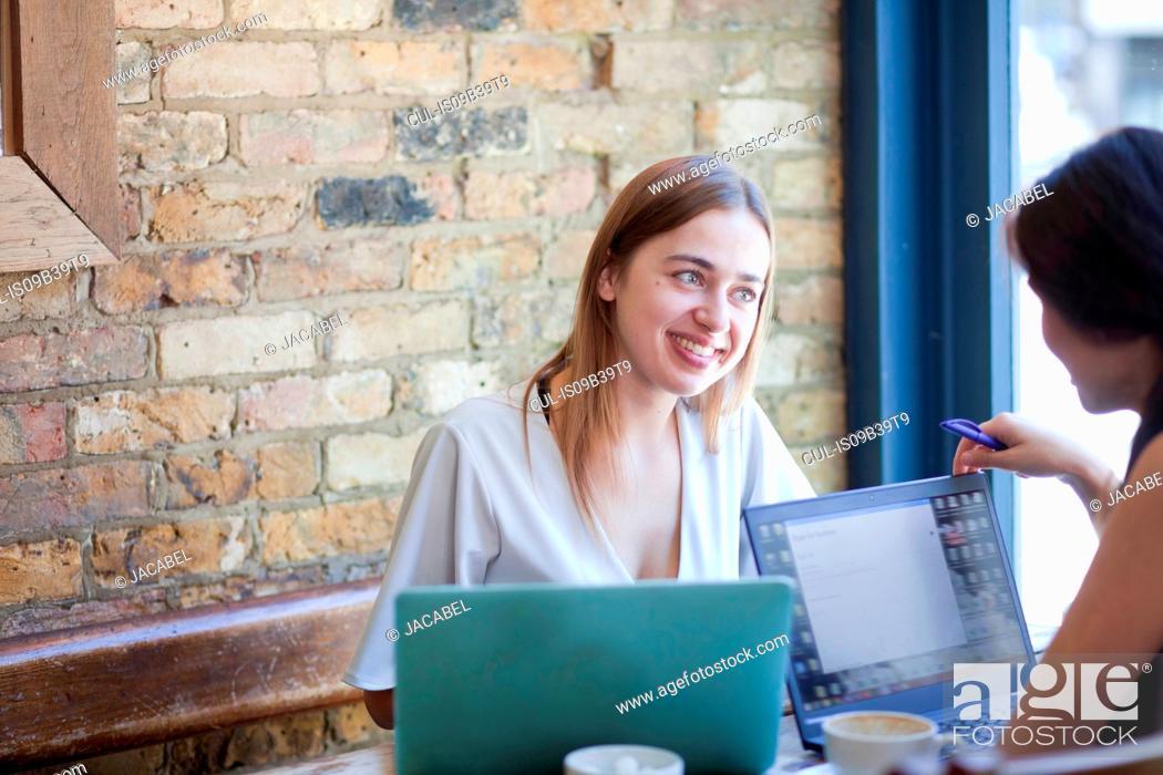Stock Photo: Businesswomen having meeting in coffee bar, London.