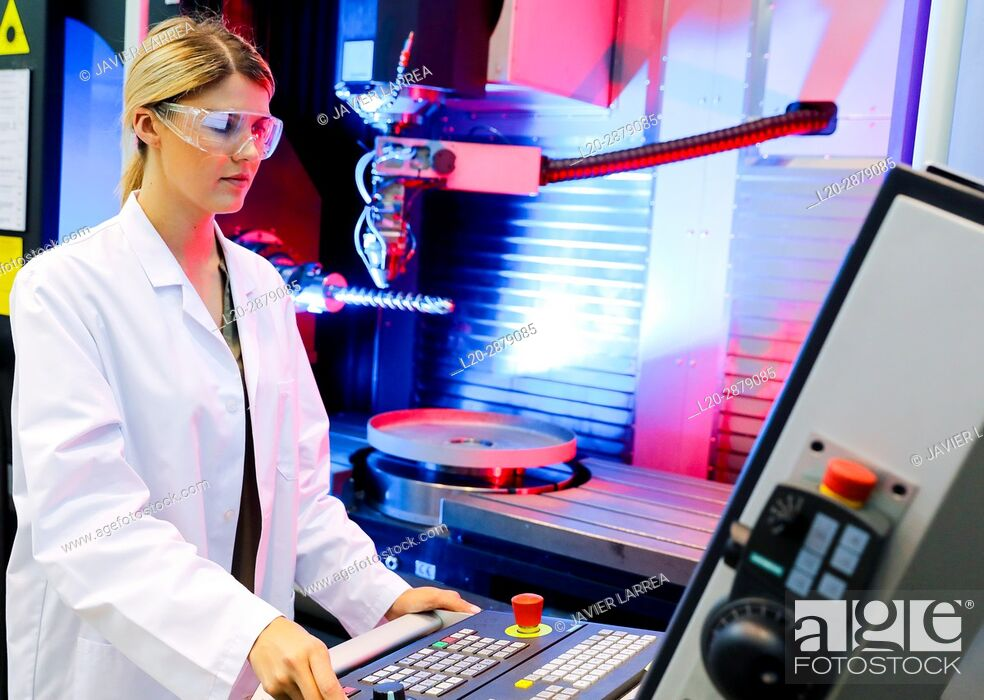 Stock Photo: Hybrid laser machine tool for additive manufacturing. Researcher working on 3D printing machine for the industry, it allows to create large metal parts from.