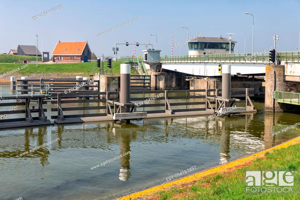 Stock Photo: Bridge and sluice in Afsluitdijk near Kornwerderzand in the Netherlands. This is the seperation of the salt Wadden Sea and the fresh water lake IJsselmeer.