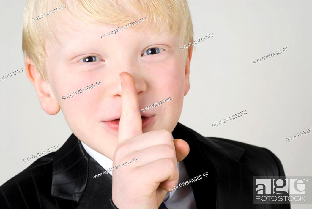 Stock Photo: Close-up of a boy with silence gesture.