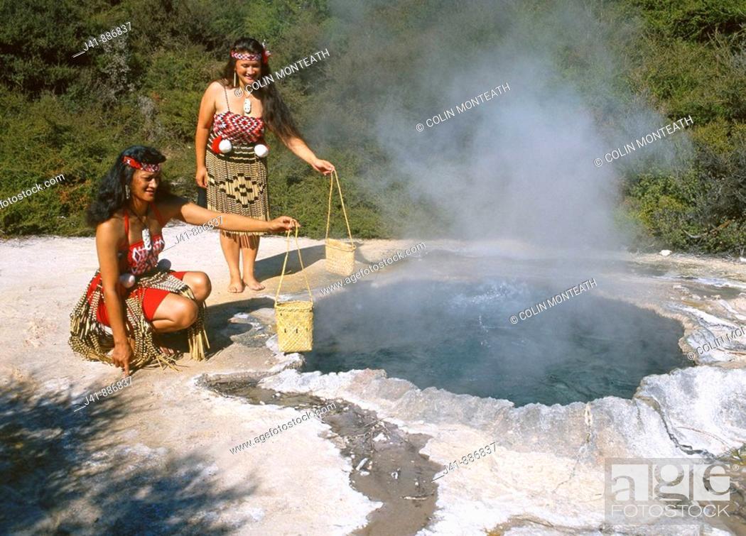 Stock Photo: Maori women cooking food in hot pool Whakarewarewa Rotorua New Zealand.