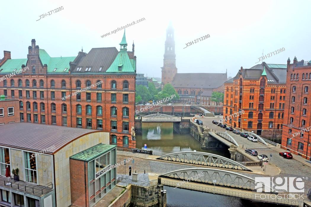 Stock Photo: aerial view of the Kleines Fleet canal in the Speicherstadt (City of Warehouses) with St. Catherine's Church in the background, HafenCity quarter, Hamburg.