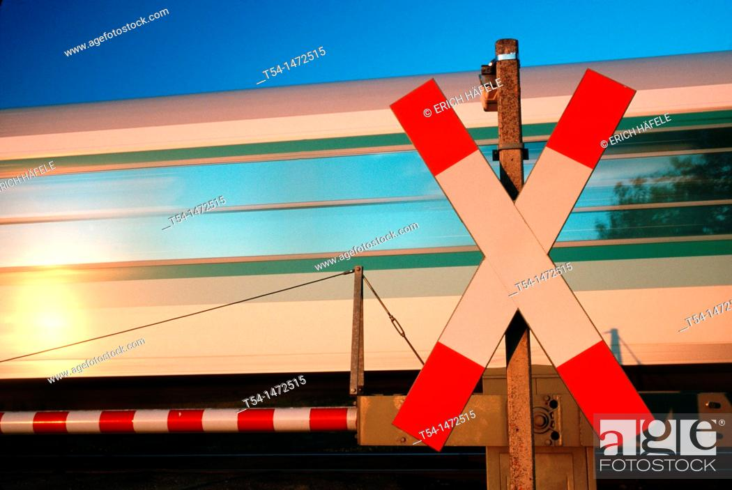 Stock Photo: Moving train at level crossing.