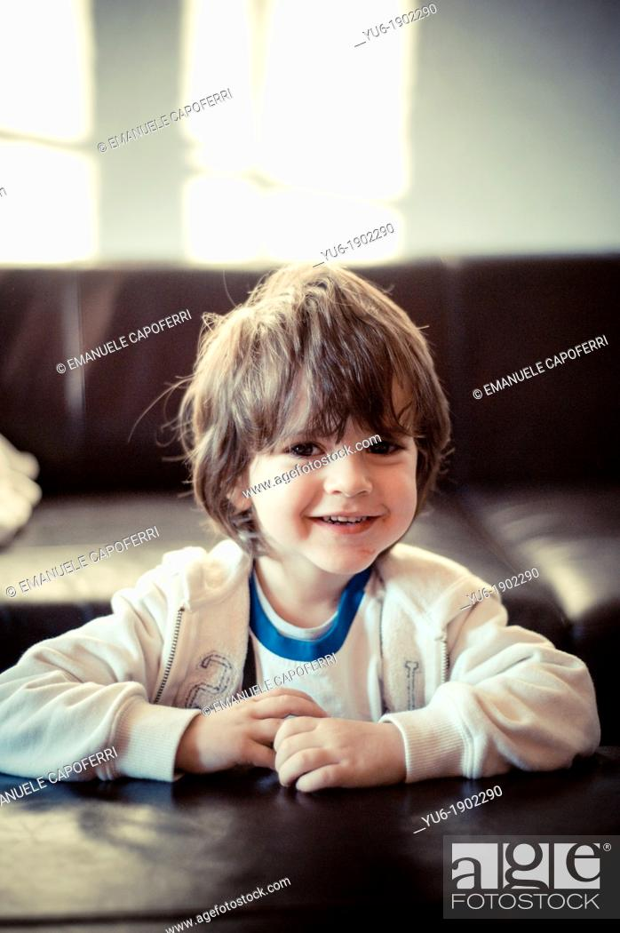 Stock Photo: Portrait of child smiling.