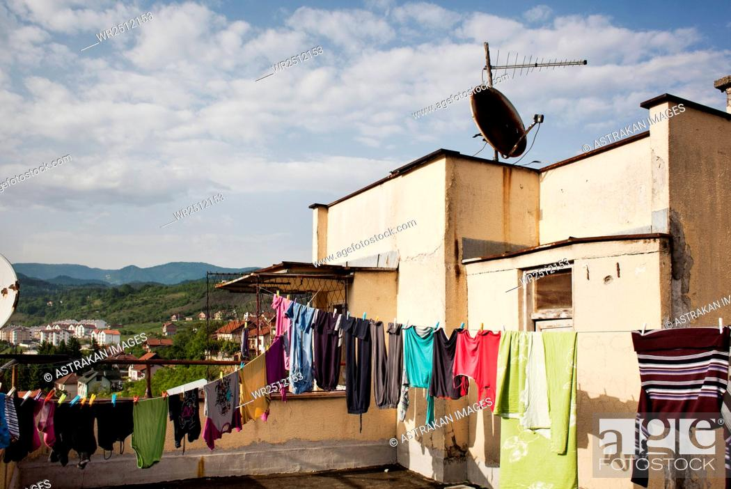 Stock Photo: Laundry hanging on clothesline at terrace.