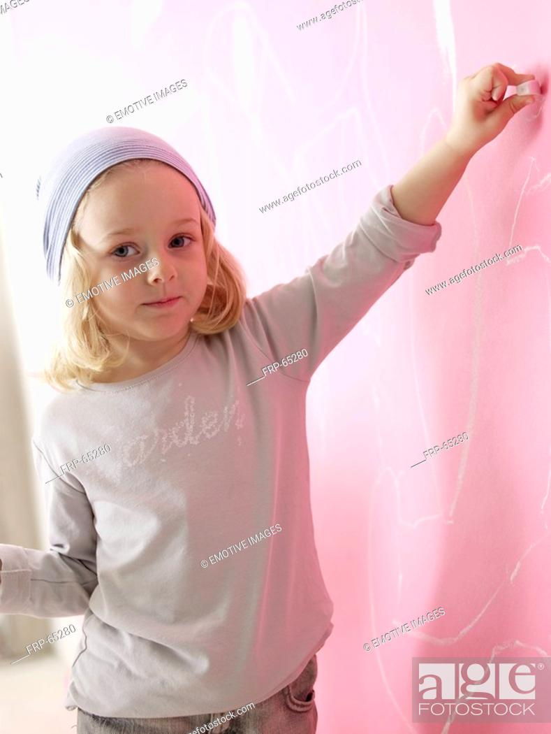 Stock Photo: Blond girl wearing a headscarf is painting.
