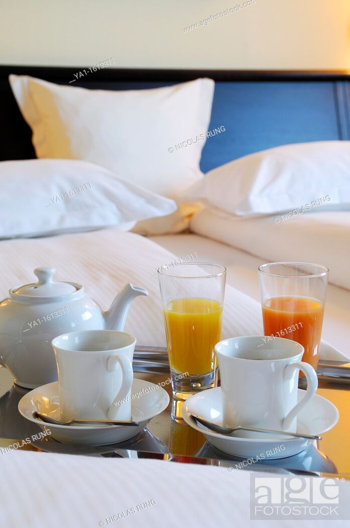 Stock Photo: French continental breakfast in bed, hotel room, Paris.